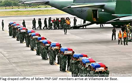 Flag-draped coffins of fallen PNP-SAF members arrive at Villamore Air Base